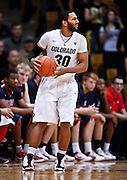 SHOT 1/21/12 5:34:38 PM - Colorado's Carlon Brown #30 looks to pass to a teammate against Arizona during their PAC 12 regular season men's basketball game at the Coors Events Center in Boulder, Co. Colorado won the game 64-63..(Photo by Marc Piscotty / © 2012)