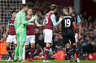 Goalkeeper Adrian of West Ham United argues with Jonathan Walters of Stoke City after he is pushed back into his own net after a corner. Barclays Premier league match, West Ham Utd v Stoke city at the Boleyn Ground, Upton Park  in London on Saturday 12th December 2015.<br /> pic by John Patrick Fletcher, Andrew Orchard sports photography.