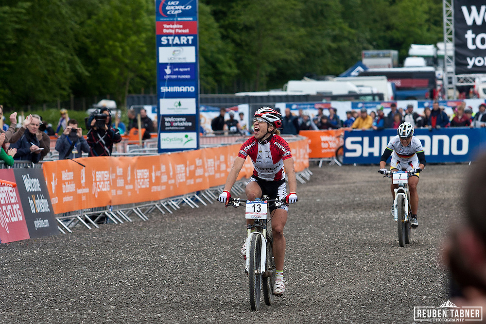 © Reuben Tabner. .Dalby Forest, North Yorkshire, UK  22/05/11. .Annika Langvad of Denmark celebrates her second place finish in the elite womens race..Women's Elite Cross-Country Olympic 2..2011 UCI Mountain Bike Cross-Country World Cup at Dalby Forest..Please see special instructions for usage rates. Photo credit should read: Reuben Tabner