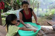 Emilia Martínez, a Ngäbe woman and member of COCABO, helps prepare lunch for a co-op members meeting. COCABO: Valle de Agua Arriba, Almirante, Changuinola, Bocas del Toro, Panamá. September 1, 2012.