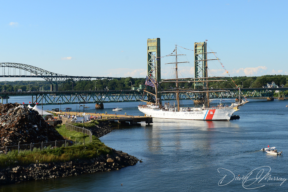 The U.S. Coast Guard Eagle sails into Portsmouth Harbor on August 2, 2013, to participate in Sail Portsmouth, hosted by the Piscataqua Maritime Commission. Kittery, ME, the Sarah Long Bridge, and the I-95 Bridge are in the background.