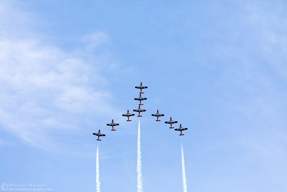 Canadian Forces Snowbirds in a Canada Goose formation with smoke.  The Snowbirds are also known as the 431 Air Demonstration Squadron and fly the Canadair CT-114 Tutor jet. Photographed during the Canada 150 celebrations in White Rock, British Columbia, Canada.