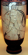 The perfect warrior even in death.  A bearded hoplite warrior is shown on this oil-flask in an attacking pose, a painted inscription calls him 'beautiful' (kalos).  The flask was found Eretria, in a tomb that may have belonged to an Athenian settler there. Made in Athens, about 420 BC