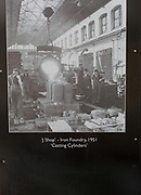Public display of old historic images about the GWR works, Swindon, Wiltshire, England, UK - J shop iron foundry 1951 casting cylinders