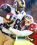 Rams' Marshall Faulk is driven out of bounds by 49ers' safety Zack Bronson in the fourth quarter at 3COM Park in San Francisco, Sunday, Sept. 23, 2001. The Rams won 30-26. (AP Photo/John Todd), Sports Action.
