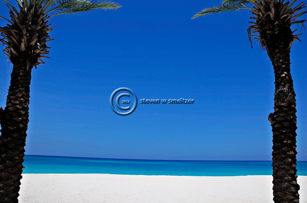 Along Seven Mile Beach Grand Cayman. Sandy beach, vacation, relaxation.