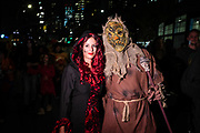 New York, NY - 31 October 2019. the annual Greenwich Village Halloween Parade along Manhattan's 6th Avenue. A woman with a spider crawling up her face stands with a man with a death's head.