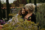 LEAH WOOD AND JO WOOD, Press Preview of the RHS Chelsea Flower Show sponsored by Saga Insurance Services. Royal Hospital Rd. London. 22 May 2006. ONE TIME USE ONLY - DO NOT ARCHIVE  © Copyright Photograph by Dafydd Jones 66 Stockwell Park Rd. London SW9 0DA Tel 020 7733 0108 www.dafjones.com