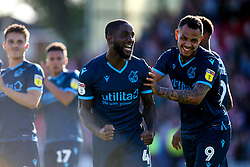 Abu Ogogo of Bristol Rovers celebrates with Jonson Clarke-Harris of Bristol Rovers after beating Lincoln City - Mandatory by-line: Robbie Stephenson/JMP - 14/09/2019 - FOOTBALL - Sincil Bank Stadium - Lincoln, England - Lincoln City v Bristol Rovers - Sky Bet League One