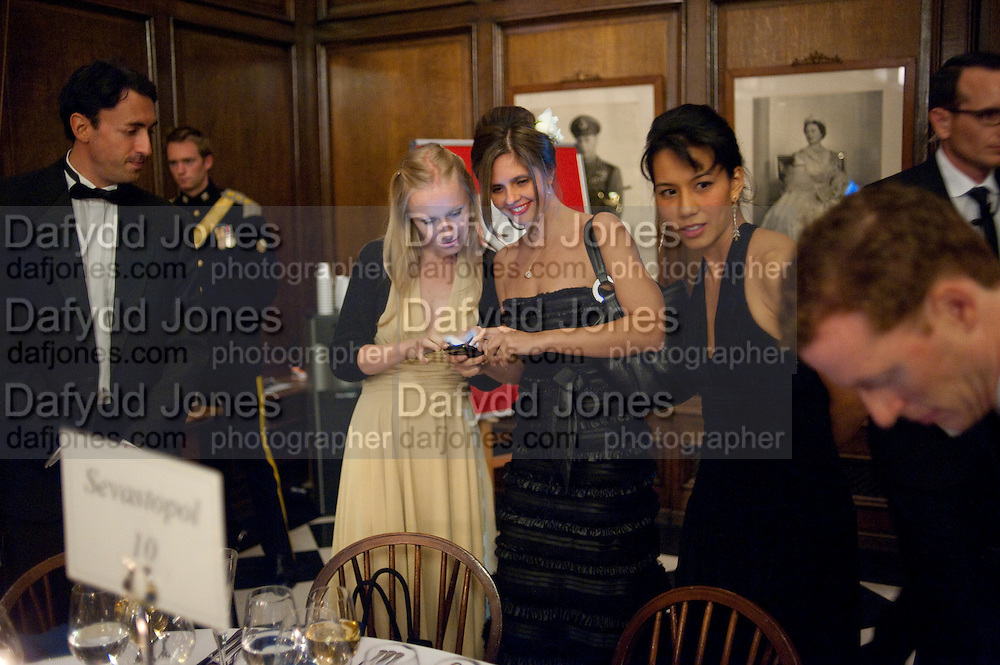 CHRIS NIXON; VICTORIA BAKER DULY; NADIA MARTIN; ISA MORIYAMA, Charity Dinner in aid of Caring for Courage The Royal Scots Dragoon Guards Afganistan Welfare Appeal. In the presence of the Duke of Kent. The Royal Hospital, Chaelsea. London. 20 October 2011. <br /> <br />  , -DO NOT ARCHIVE-© Copyright Photograph by Dafydd Jones. 248 Clapham Rd. London SW9 0PZ. Tel 0207 820 0771. www.dafjones.com.