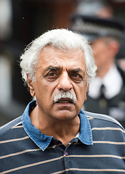 © Licensed to London News Pictures. 19/08/2012. Tariq Ali speaking to the media before Wikileaks founder Julian Assange speaks from a balcony at The Ecuador Embassy in London on August 19/08/2012. Assange, who faces arrest by British police if he leaves the building, took refuge in the embassy on June 19 to evade extradition to Sweden where he is wanted for questioning over alleged sexual misconduct. Photo credit : Ben Cawthra/LNP