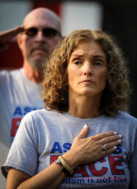 Deb Moyer, mother of the late Ashly Moyer of Macungie takes part in a memorial ceremony along with hundreds of runners who participated in the annual 5k Race For Freedom which is held in the Lehigh Parkway. Ashly was an Army soldier killed in Baghdad in 2007.    ///////\\\\\\\            DONNA FISHER/THE MORNING CALL     ALLENTOWN   Pic made FRIDAY, SEPTEMBER 3, 2011