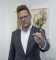 May 3, 2017 - New York, United States - Former Metallica bass guitarist Jason Newsted debuts his first art exhibition ''RAWK'' during VIP preview at the contemporary Art Fairs: Art New York, Context New York 2017, Pier 94, Manhattan (Credit Image: © Sam Aronov/Pacific Press via ZUMA Wire)