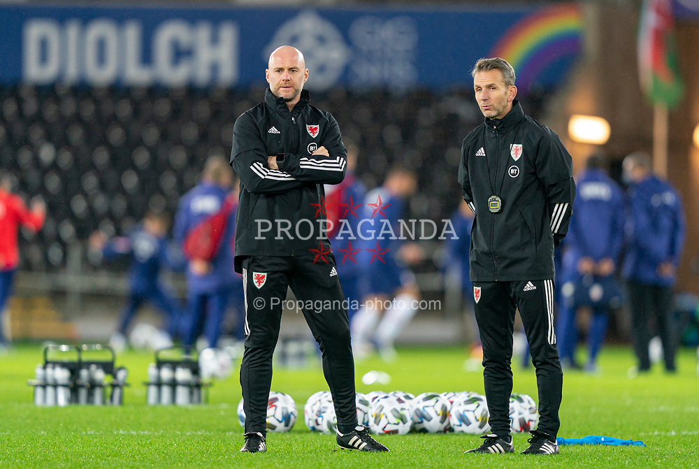SWANSEA, WALES - Thursday, November 12, 2020: Wales' assistant coach Robert Page (L), who stands in for manager Ryan Giggs after he was arrested on suspicion of assault, with assistant coach Albert Stuivenberg during the pre-match warm-up before an International Friendly match between Wales and the USA at the Liberty Stadium. (Pic by David Rawcliffe/Propaganda)