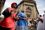Dancers perform on the streets during the Fire festival in Santiago, Cuba on Wednesday July 9, 2008.