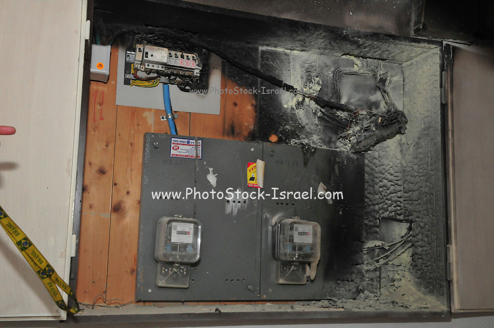 A fire broke out in a household electrical fuse box flames consumed the board. The burnt fuse box Photographed in Israel