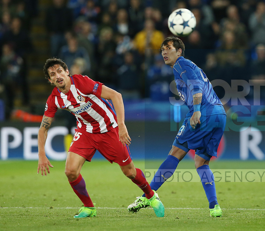 Leicester's Leonardo Ulloa tussles with Atletico's Stefan Savic during the Champions League Quarter-Final 2nd leg match at the King Power Stadium, Leicester. Picture date: April 18th, 2017. Pic credit should read: David Klein/Sportimage