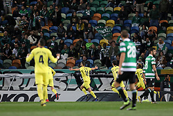 February 14, 2019 - Lisbon, Portugal - Alfonso Pedraza of Villarreal FC celebrates with teammates after scoring during the Europa League 2018/2019 footballl match between Sporting CP vs Villarreal FC. (Credit Image: © David Martins/SOPA Images via ZUMA Wire)