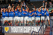 The Rangers team hold the trophy aloft after winning the Scottish FA Youth Cup Final match between Celtic and Rangers at Hampden Park, Glasgow, United Kingdom on 25 April 2019.