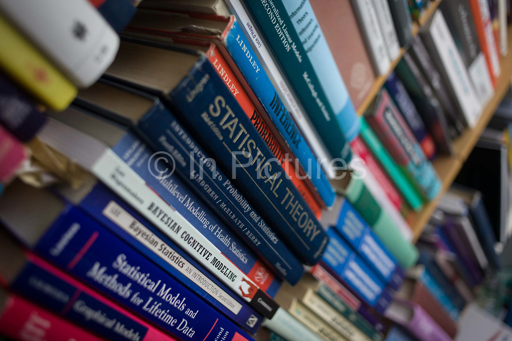 Text books about maths, probablity and risk, belonging to mathematician and Risk guru, Professor David Spiegelhalter at the Centre for Mathematical Sciences at the University of Cambridge. Titles of academic works by the intelligentsia sit on the shelf in his office. S ir David John Spiegelhalter (1953), OBE FRS, is a British statistician. In 2007 he was elected Winton Professor of the Public Understanding of Risk in the Statistical Laboratory, University of Cambridge and a Fellow of Churchill College, Cambridge. From the chapter entitled 'Possible Futures' and from the book 'Risk Wise: Nine Everyday Adventures' by Polly Morland (Allianz, The School of Life, Profile Books, 2015).