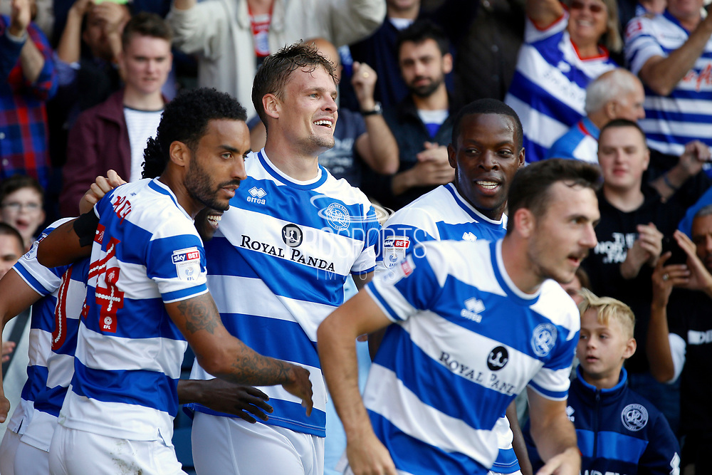 QPR players celebrate a goal from QPR Forward Matt Smith (17) (score 1-1) during the EFL Sky Bet Championship match between Queens Park Rangers and Hull City at the Loftus Road Stadium, London, England on 19 August 2017. Photo by Andy Walter.