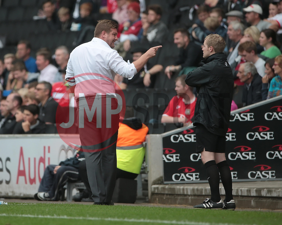 Milton Keynes Dons Manager, Karl Robinson makes a point to 4th official Gavin Ward  - Photo mandatory by-line: Nigel Pitts-Drake/JMP - Tel: Mobile: 07966 386802 24/08/2013 - SPORT - FOOTBALL - Stadium MK - Milton Keynes - Milton Keynes Dons V Bristol City - Sky Bet League One