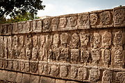 Tzompantli or Skull Platform in Chichen Itza, a large pre-Columbian city built by the Mayans. Displayed are the skulls of human sacrifices. Other platforms show scenes with  human sacrifice, eagles eating all human hearts, and skeletonized warriors with arrows and shields.