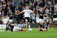 DERBY, ENGLAND - MAY 11: - DCFC vs Fulham. Tom Lawrence, evades a tackle