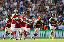 Arsenal's players celebrate winning the penalty shoot out against Chelsea