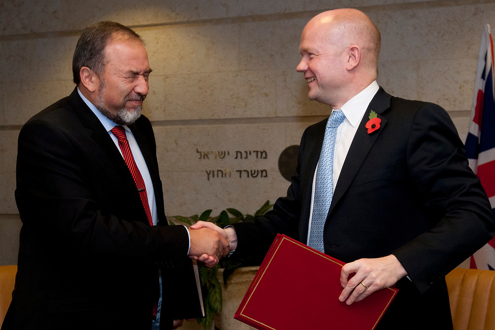 British Foreign Secretary William Hague (R) and Israeli Minister of Foreign Affairs Avigdor Lieberman shake hands after signing a bilateral film co-production agreement, which will increase cooperation between the film industries of the two countries, at the Ministry of Foreign Affairs in Jerusalem, on November 3, 2010.
