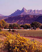 Two Feathers Ranch along the Virgin River with Eagle Crags of the Vermilion Cliffs beyond, Rockville, Utah.