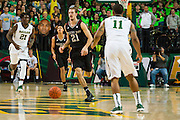 WACO, TX - DECEMBER 9: Alex Caruso #21 of the Texas A&M Aggies brings the ball up court against the Baylor Bears on December 9, 2014 at the Ferrell Center in Waco, Texas.  (Photo by Cooper Neill/Getty Images) *** Local Caption *** Alex Caruso