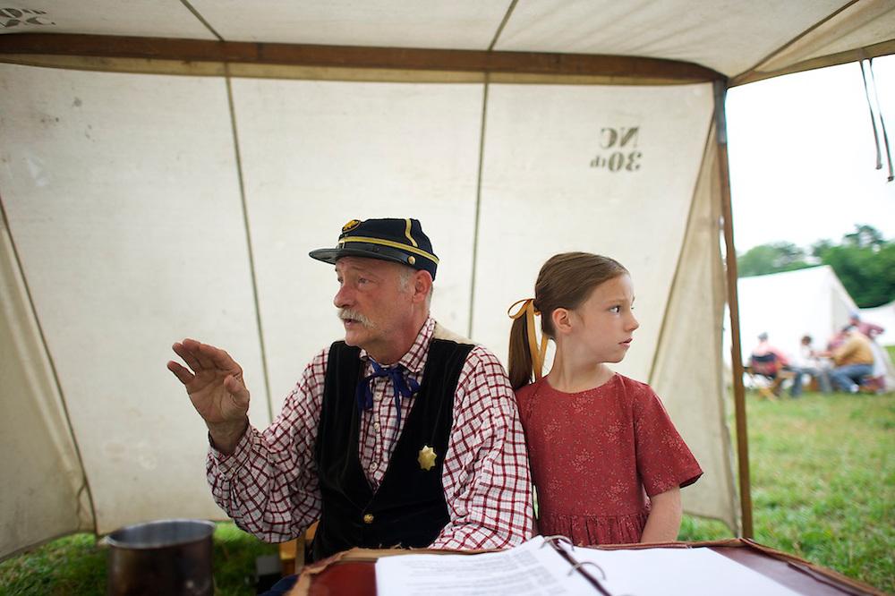 Walter Hilderman III, a 50 year reenactor, in camp with his granddaughter, Sarah Jane McClellan, 7, the first morning of the four day Gettysburg Anniversary Committee 150th Gettysburg reenactment in Gettysburg, PA on July 4, 2013.