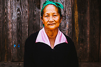 A portrait of Pang Kang, 68, the village leader's mother, in Khon Kahndone Village, Laos.