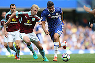 Diego Costa of Chelsea runs past Ben Mee of Burnley. Premier league match, Chelsea v Burnley at Stamford Bridge in London on Saturday 27th August 2016.<br /> pic by John Patrick Fletcher, Andrew Orchard sports photography.