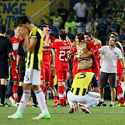 Fenerbahce's Mehmet Topal (L) and Spartak Moscow's players celebrate their victory over Fenerbahce during their UEFA Champions League Play-Offs, 2nd leg soccer match Fenerbahce between Spartak Moscow at Sukru Saracaoglu stadium in Istanbul Turkey on Wednesday 29 August 2012. Photo by TURKPIX