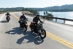 Todd Kraft, Doug Feinsod and Jody Perewitz ride beside Pactola Reservoir 15-miles west of Rapid City during the Motorcycle Cannonball coast to coast vintage run. Stage 9 (294 miles) from Pierre to Sturgis, SD. Sunday September 16, 2018. Photography ©2018 Michael Lichter.