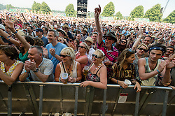 © Licensed to London News Pictures. 18/07/2014. Southwold, UK.  Festival goers at the front of the audience of the main stage at Latitude Festival 2014 Day 1.   Latitude is an British annual music festival.  Photo credit : Richard Isaac/LNP