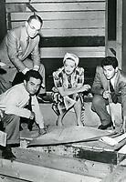 1942 (L to R)Jules Stein, Al Ybarra, Bette Davis & John Garfield planning the construction of the Hollywood Canteen