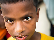 01 JUNE 2015 - KULAI, JOHORE, MALAYSIA:  A Rohingya refugee boy in Kulai, Malaysia. The UN says the Rohingya, a Muslim minority in western Myanmar, are the most persecuted ethnic minority in the world. The government of Myanmar insists the Rohingya are illegal immigrants from Bangladesh and has refused to grant them citizenship. Most of the Rohingya in Myanmar have been confined to Internal Displaced Persons camp in Rakhine state, bordering Bangladesh. Thousands of Rohingya have fled Myanmar and settled in Malaysia. Most fled on small fishing trawlers. There are about 1,500 Rohingya in the town of Kulai, in the Malaysian state of Johore. Only about 500 of them have been granted official refugee status by the UN High Commissioner for Refugees. The rest live under the radar, relying on gifts from their community and taking menial jobs to make ends meet. They face harassment from Malaysian police who, the Rohingya say, extort bribes from them.       PHOTO BY JACK KURTZ