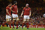 Sam Warburton (l) the Wales capt, Luke Charteris © and Jake Ball look on during a break in play. Rugby World Cup 2015 pool A match, Wales v Uruguay at the Millennium Stadium in Cardiff, South Wales  on Sunday 20th September 2015.<br /> pic by  Andrew Orchard, Andrew Orchard sports photography.