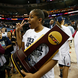 Apr 9, 2013; New Orleans, LA, USA; Connecticut Huskies forward Kaleena Mosqueda-Lewis (23) celebrates with the championship trophy after the championship game in the 2013 NCAA womens Final Four against the Louisville Cardinals at the New Orleans Arena. Connecticut defeated Louisville 93-60. Mandatory Credit: Derick E. Hingle-USA TODAY Sports