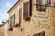 Hotel Restaurant Gardette sign, France Beautiful village of St Amand de Coly, Dordogne in Aquitaine, France