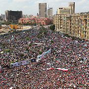 Sea of protesters in Cairo's Tahrir Square with the Egyptian Museum and burned out National Council for Women behind.