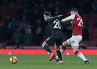 Football - 2017 / 2018 Premier League - Arsenal vs. Manchester City<br /> <br /> GranitXhaka (Arsenal FC) has a hold of Bernardo Silva (Manchester City) to prevent his run at The Emirates.<br /> <br /> COLORSPORT/DANIEL BEARHAM