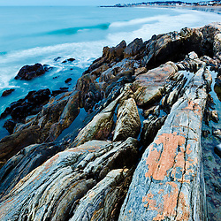 The colorful rock ledges at Wallis Sands State Park in Rye, New Hampshie.