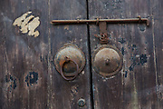 Traditional door and brass knobs Shantang canal in Suzhou, China.