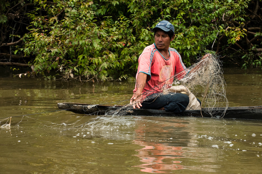 Amerinidian Fisherman<br /> Essequibo River<br /> Iwokrama Forest Reserve<br /> GUYANA<br /> South America