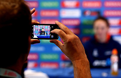A journalist takes a picture of Amy Satterthwaite of New Zealand Women on a phone as she takes part in a Press Conference ahead of her side's World Cup Group Match against, England Women, in which she will win her 100th cap - Mandatory by-line: Robbie Stephenson/JMP - 11/07/2017 - CRICKET - Bristol County Ground - Bristol, United Kingdom - England v New Zealand - ICC Women's World Cup