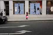 A walking theme shop window display at Louis Vuitton on Bond Street, central London.